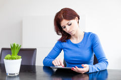 Attractive woman with Tablet PC Royalty Free Stock Images