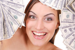 Attractive woman takes lot of 100 dollar bills Stock Photos