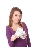 Attractive woman takes lot of 100 dollar bills Royalty Free Stock Image