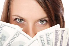 Attractive woman takes lot of 100 dollar bills Royalty Free Stock Photography
