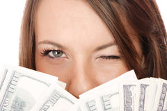 Attractive woman takes lot of 100 dollar bills Royalty Free Stock Photos