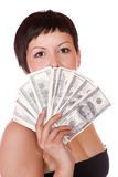Attractive woman takes lot of 100 dollar bills Stock Images