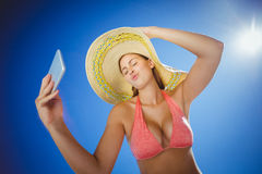 Attractive woman taking selfie against sky Royalty Free Stock Photography
