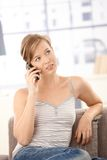 Attractive woman talking on mobile at home Royalty Free Stock Photo