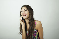 Attractive woman talking on mobile phone Stock Photo