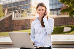 Attractive woman talking on a mobile phone Stock Images