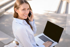 Attractive woman talking on a mobile phone Stock Image