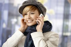 Attractive woman talking on mobile wintertime Royalty Free Stock Photo