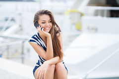 Attractive woman talking on the phone Royalty Free Stock Photos