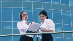 Attractive woman talking to her opponent and discussing their business plans. Attractive woman talking to her opponent outdoors and discussing their plans on stock video footage