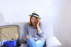 Attractive woman talks on cell phone with friend and writes to n stock photos
