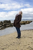 Attractive woman at Tasmanian beach Stock Images