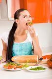 Attractive woman tasting fresh healthy sandwiches Royalty Free Stock Image