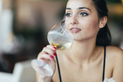 Attractive woman tasting white wine Royalty Free Stock Photo
