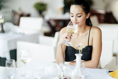Attractive woman tasting white wine Royalty Free Stock Image