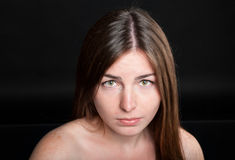 Attractive woman with tears on her face Stock Photography
