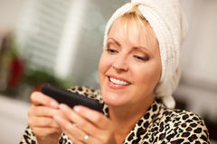 Attractive Woman Texting With Her Cell Phone Royalty Free Stock Photography