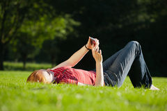An attractive woman texting on her mobile Stock Image