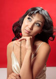 Attractive woman thinking Royalty Free Stock Photography