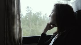 Attractive Woman In Thought Looking Out of a Train Window, Slow Motion, Travel Concept stock video