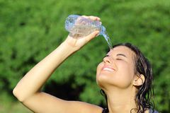 Attractive Woman Throwing Herself Water From A Bottle Royalty Free Stock Image