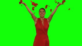 Attractive woman throwing red petals in the air stock video