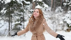 Attractive woman throws snow up stock video