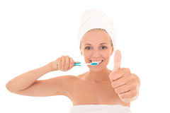 Attractive woman with toothbrush and towel thumbs up  Royalty Free Stock Images