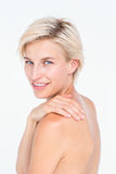 Attractive woman touching her shoulder Royalty Free Stock Images