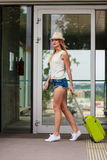 Attractive woman tourist with suitcase walking from flight Royalty Free Stock Image