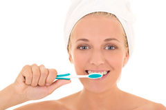Attractive woman in towel with toothbrush Stock Images