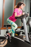 Attractive woman training and riding the bicycle Stock Photo
