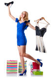 Attractive woman trying new clothing. On white Royalty Free Stock Photography