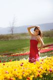 Attractive woman in tulip filed stock photo