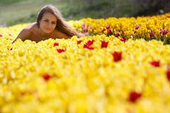 Attractive woman in tulip filed Royalty Free Stock Photos