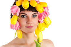 Attractive woman with tulips on the head Stock Image