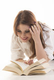 Attractive Woman With Two Books Lying On Floor Stock Images