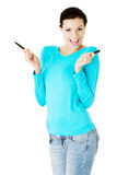 Attractive woman with two pens. Stock Photos