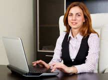 Attractive woman typing on laptop Royalty Free Stock Photo