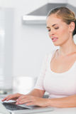 Attractive woman typing on laptop Stock Image