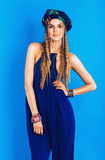 Attractive woman in ultramarine turban and overall Royalty Free Stock Image