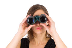 Attractive woman using binoculars Royalty Free Stock Photography