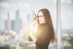 Attractive woman using cellular phone Royalty Free Stock Photo