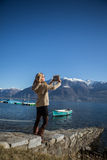 Attractive woman using digital tablet by the lake Royalty Free Stock Image