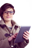 Attractive woman using her tablet pc Royalty Free Stock Photo