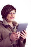 Attractive woman using her tablet pc Stock Images