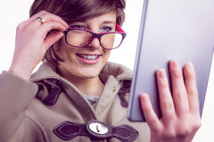 Attractive woman using her tablet pc Royalty Free Stock Photography