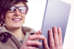 Attractive woman using her tablet pc Royalty Free Stock Image