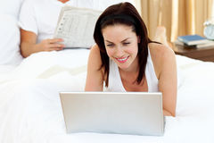 Attractive woman using laptop Stock Photo