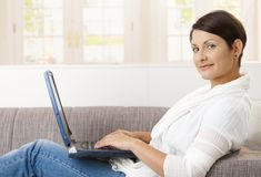 Attractive woman using laptop Stock Image